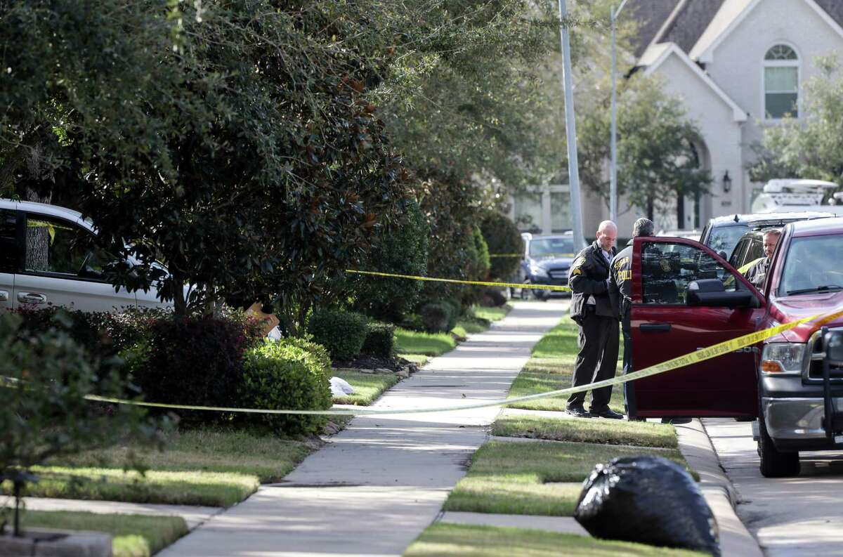 Authorities investigate a possible murder-suicide in the 1200 block of Pendergrass Trail, Monday, Feb. 18, 2019, in Sugar Land.