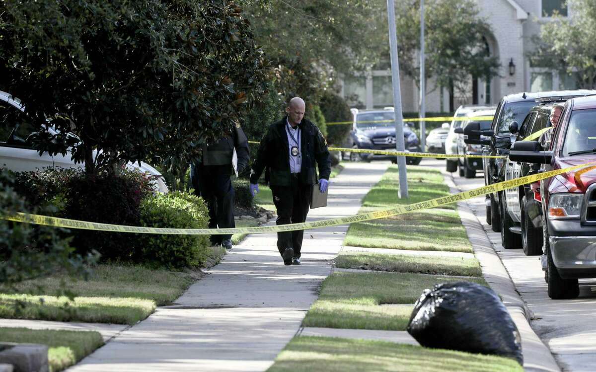 Authorities investigate a possible murder-suicide in the 1200 block of Pendergrass Trail, Monday, Feb. 18, 2019, in Sugar Land. >>>See crimes that shocked Houston suburbs last year ...