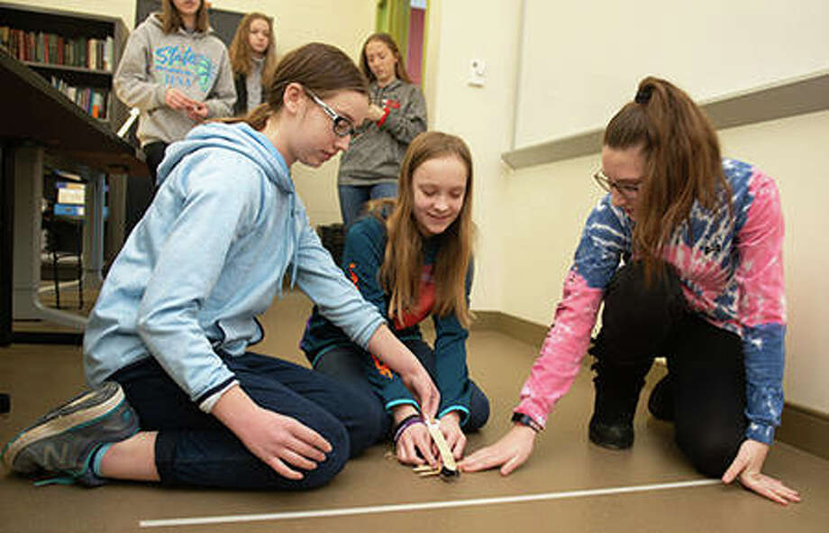 (L-R): Sienna Markert, Audrey Windmiller and Anna Grace Robinson test their catapult. Photo: For The Intelligencer