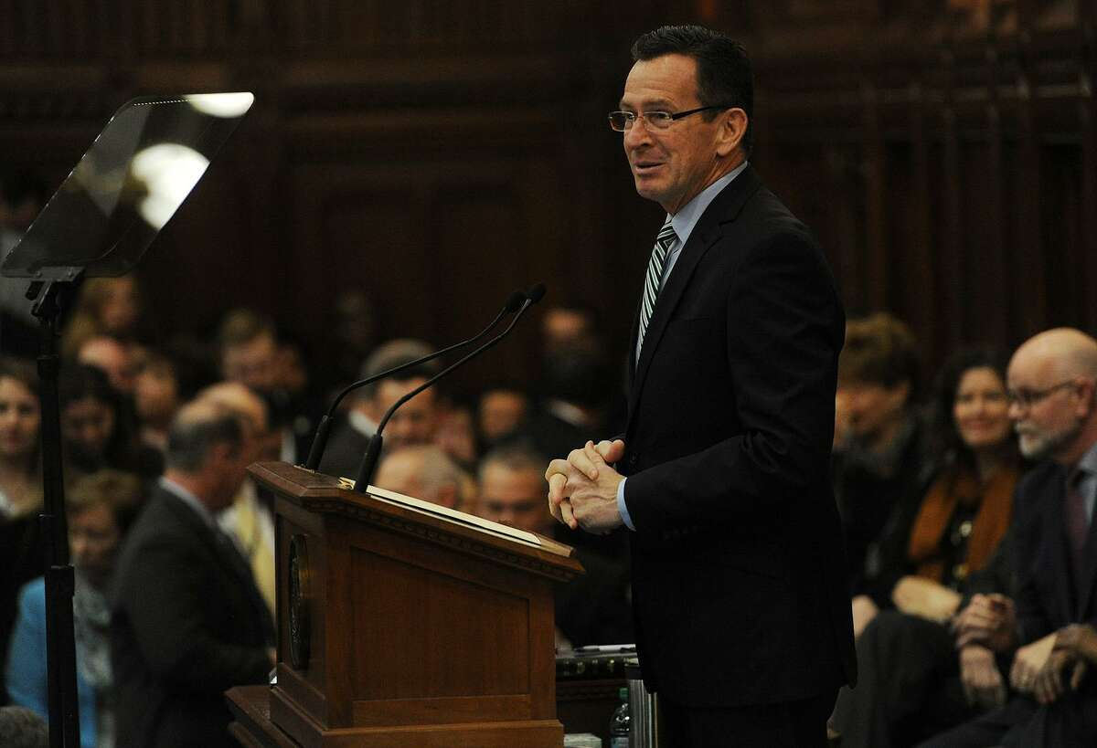 Former Gov. Dannel P. Malloy addresses a packed house chamber during opening day of the legislature at the Capitol in Hartford on Jan. 4, 2017.