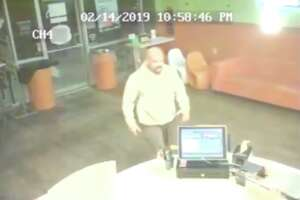 A man is accused of stealing a cash register from a Cypress-area frozen yogurt shop.