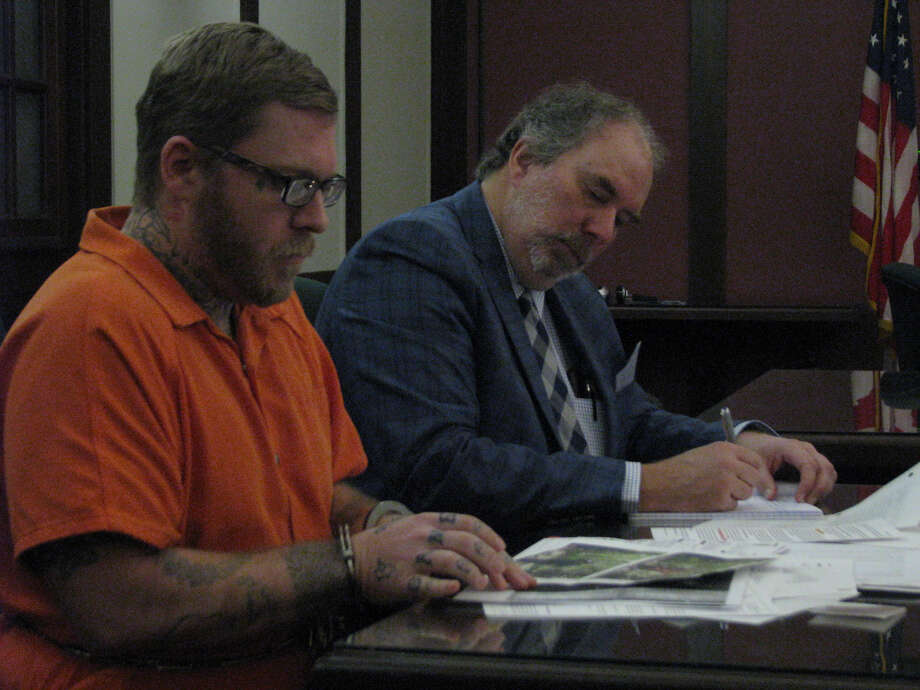 Joel Wallace, left, looks over documents with his attorney Dan Duke after his motion hearing Friday in the 42nd Circuit Court. He stands accused of the slaying of his great-aunt Victoria Jean Kilbourne of Midland, who was reported missing to the Midland Police Department on June 26. Photo: Mitchell Kukulka