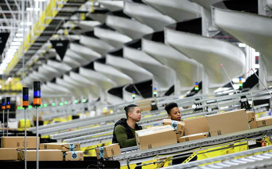 Amazon packages are sorted through a fulfillment center in Staten Island, N.Y. In both New York and Connecticut, exports of secondhand goods increased last year as more sellers ship items overseas sold on Amazon, eBay and other sites. Photo: JOHANNES EISELE / AFP /Getty Images / AFP or licensors