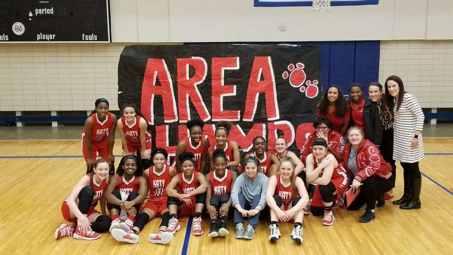 The Katy girls basketball team rallied for a 48-47 victory against Heights on Feb. 14 at Butler Field House to advance to the Region III-6A quarterfinals. The Tigers won their second area crown in three years. Photo: Katy ISD Athletics / Katy ISD Athletics
