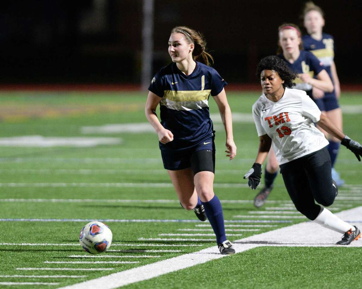 Sydney Miller (1) of Second Baptist dribbles past Sherly Bouquet (19) of TMI Episcopal during the first half of TAPPS Area Championship soccer game between the Second Baptist Eagles and the TMI Episcopal Panthers on Tuesday, February 12, 2019 at The Kinkaid School, Houston, TX.