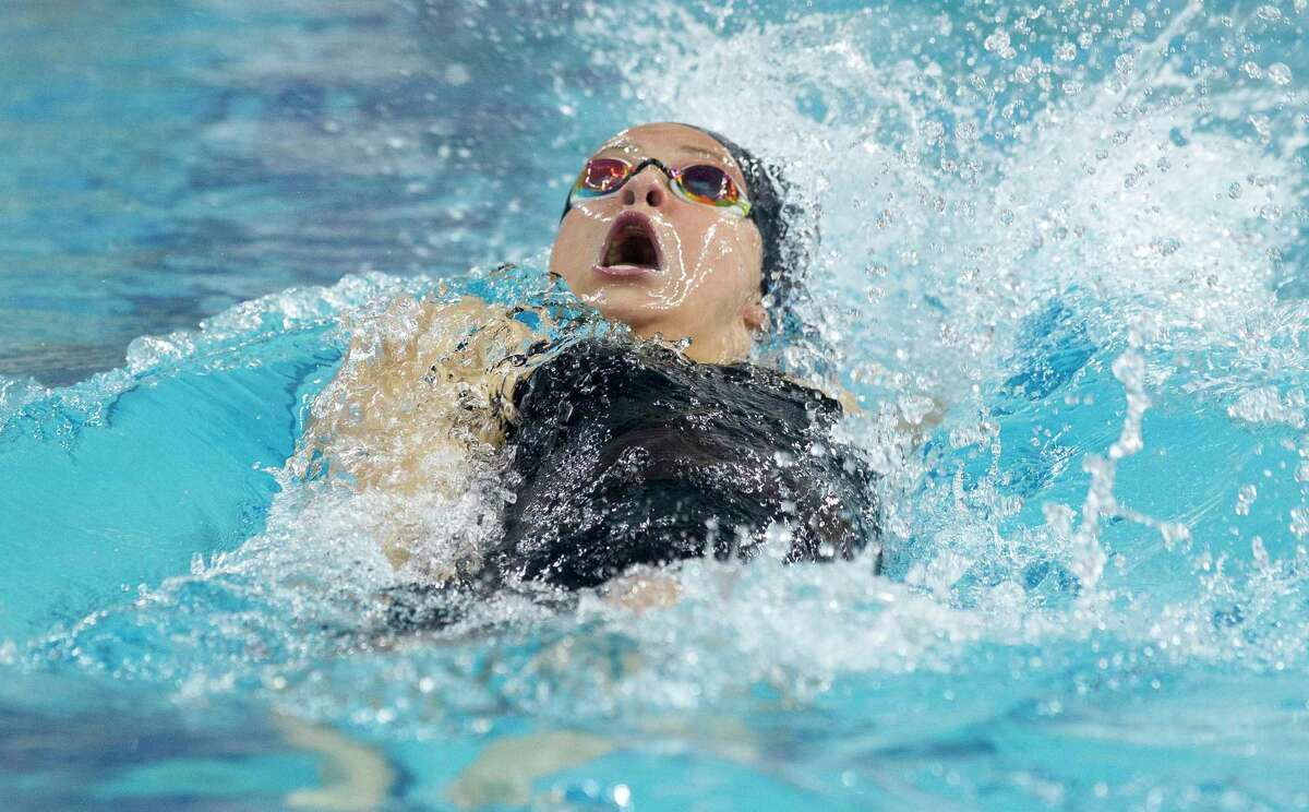 Emma Sticklen of Katy Taylor competes in the Class 6A girls 100-yard backstroke during the state meet this spring.