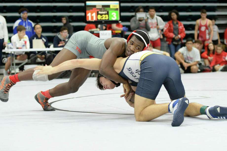 Kishawn Higgins of Katy HS and Dylan Nowak of Cy-Ranch compete in the boys 170 pound weight class during the Region III 6-A UIL Wrestling Championships on Saturday February 16, 2019 at the Merrell Center, Katy, TX. Photo: Craig Moseley, Houston Chronicle / Staff Photographer / ©2019 Houston Chronicle