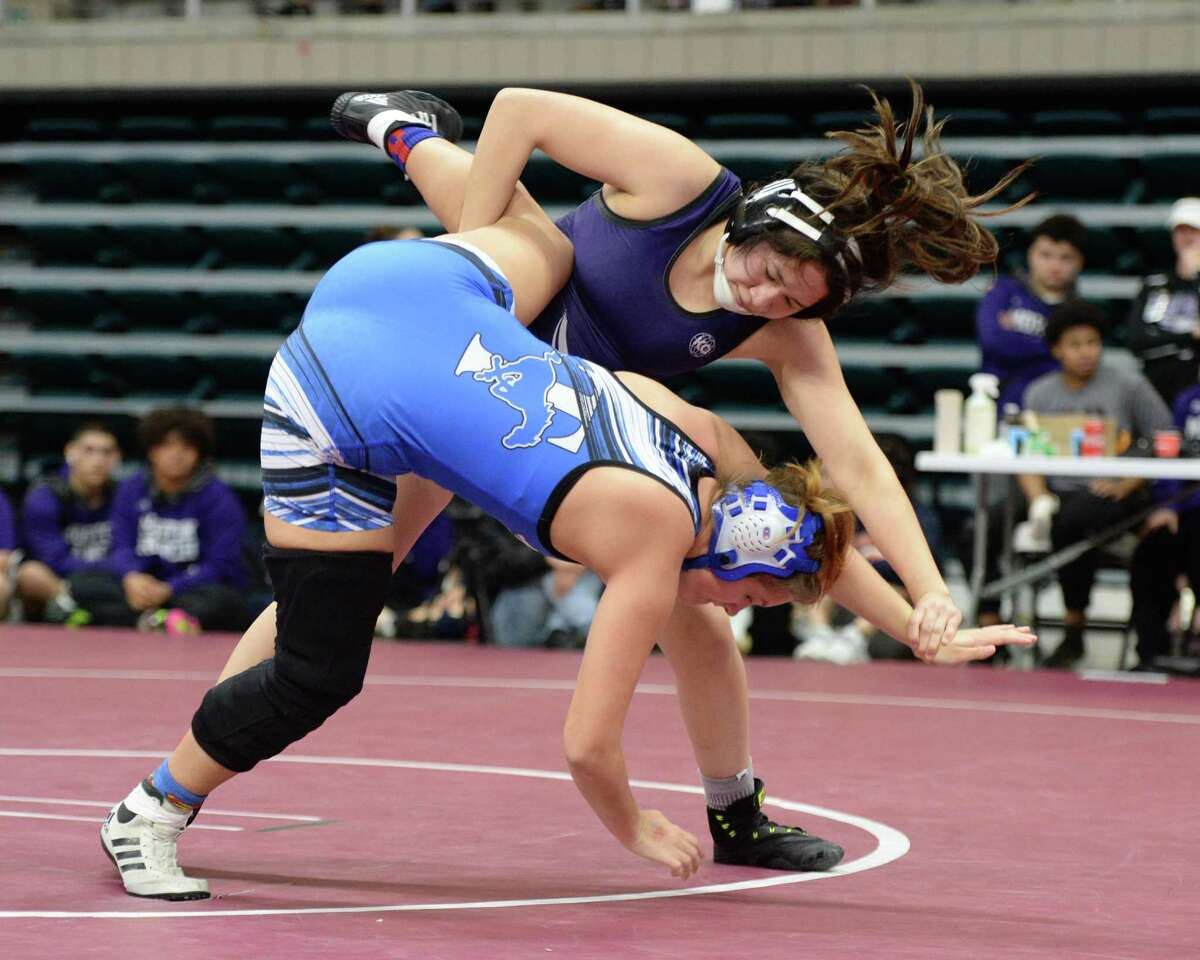 Vanessa Flores of Morton Ranch and Mary Kate Cooper of Taylor compete in the girls 148 pound weight class during the Region III 6-A UIL Wrestling Championships on Saturday February 16, 2019 at the Merrell Center, Katy, TX.