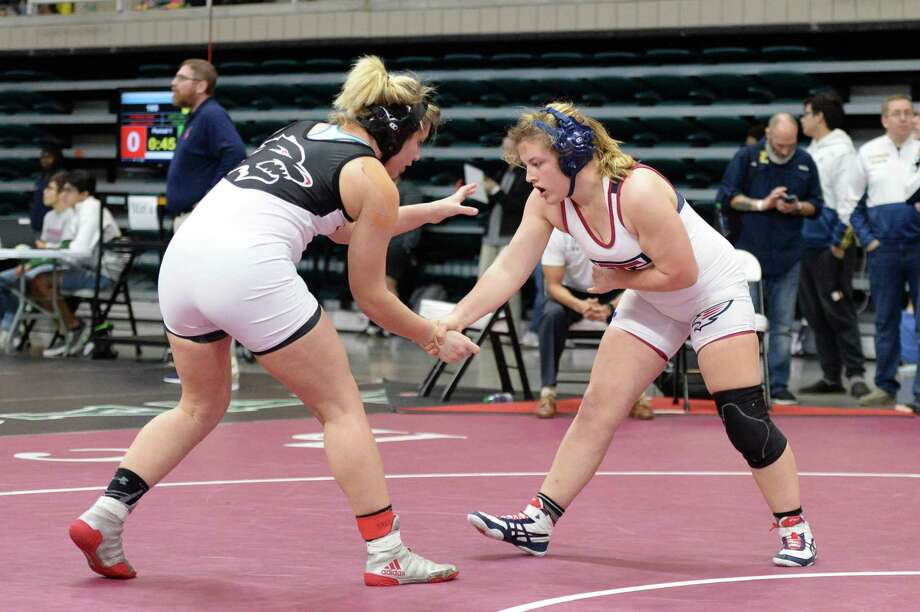 Ashley Molina of Langham Creek and Nicole Blinn of Tompkins compete in the girls 185 pound weight class during the Region III 6-A UIL Wrestling Championships on Saturday February 16, 2019 at the Merrell Center, Katy, TX. Photo: Craig Moseley, Houston Chronicle / Staff Photographer / ©2019 Houston Chronicle