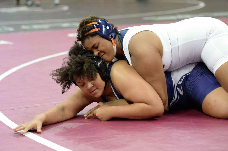 Gabi Holloway of Seven Lakes and Ashely Tapp of Morton Ranch compete in the girls 215 pound weight class during the Region III 6-A UIL Wrestling Championships on Saturday, Feb. 16, 2019, at the Merrell Center in Katy. Photo: Craig Moseley, Houston Chronicle / Staff Photographer / ©2019 Houston Chronicle