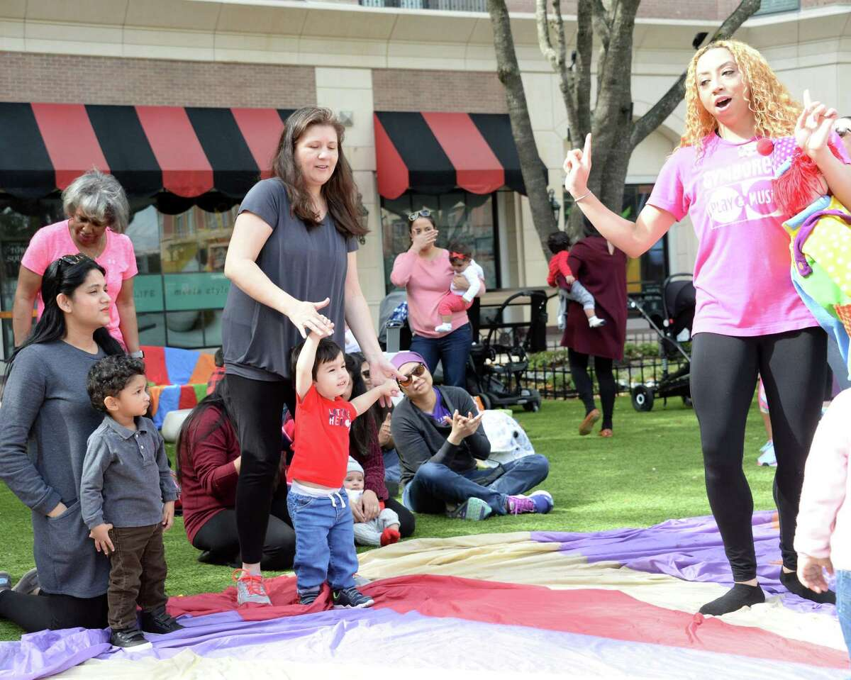 Parents and children enjoy a Parachute Play Time organized by the Missouri City location of Gymboree Play & Music at Sugar Land Town Square on Thursday, February 14, 2019.