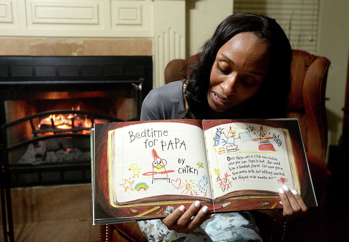 """Homer Elementary School Principal Dr. Belinda George reads from the award winning children's book """"Interrupting Chicken"""" via Facebook Live from her home Tuesday night. Dr. George does the online bedtime story readings every Tuesday since first starting the project at Christmas. Her weekly """"Tucked In Tuesdays"""" is now shared by other Beaumont ISD elementary schools, and is helping those students meet their AR Book reading requirements, as well as her Homer Elementary School scholars. After finishing the story, Dr. George engages her audience with questions and interacts with them throughout the reading. Keeping the readings enthusiastic and recording them in different parts of her home, with the occasional visit from her rescued box turtle Franny Fae, makes the storytime fun for her and for the growing number of children and parents tuning in each week. Photo taken Tuesday, January 29, 2019 Photo by Kim Brent/The Enterprise"""