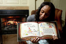 "Homer Elementary School Principal Dr. Belinda George reads from the award winning children's book ""Interrupting Chicken"" via Facebook Live from her home Tuesday night. Dr. George does the online bedtime story readings every Tuesday since first starting the project at Christmas. Her weekly ""Tucked In Tuesdays"" is now shared by other Beaumont ISD elementary schools, and is helping those students meet their AR Book reading requirements, as well as her Homer Elementary School scholars. After finishing the story, Dr. George engages her audience with questions and interacts with them throughout the reading. Keeping the readings enthusiastic and recording them in different parts of her home, with the occasional visit from her rescued box turtle Franny Fae, makes the storytime fun for her and for the growing number of children and parents tuning in each week. Photo taken Tuesday, January 29, 2019 Photo by Kim Brent/The Enterprise"