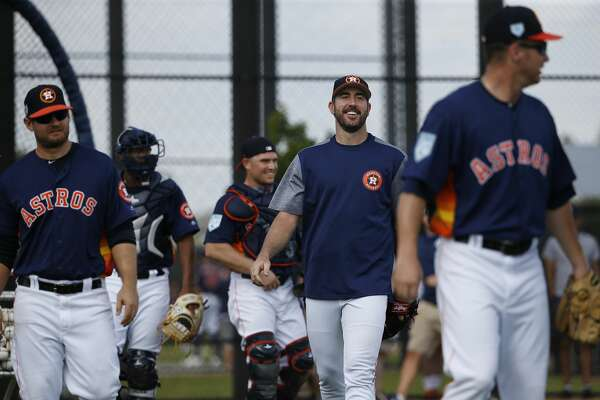 Houston Astros pitchers head off the field after a round of pitcher's field practice at Fitteam Ballpark of The Palm Beaches on Day 5 of spring training on Monday, Feb. 18, 2019, in West Palm Beach.