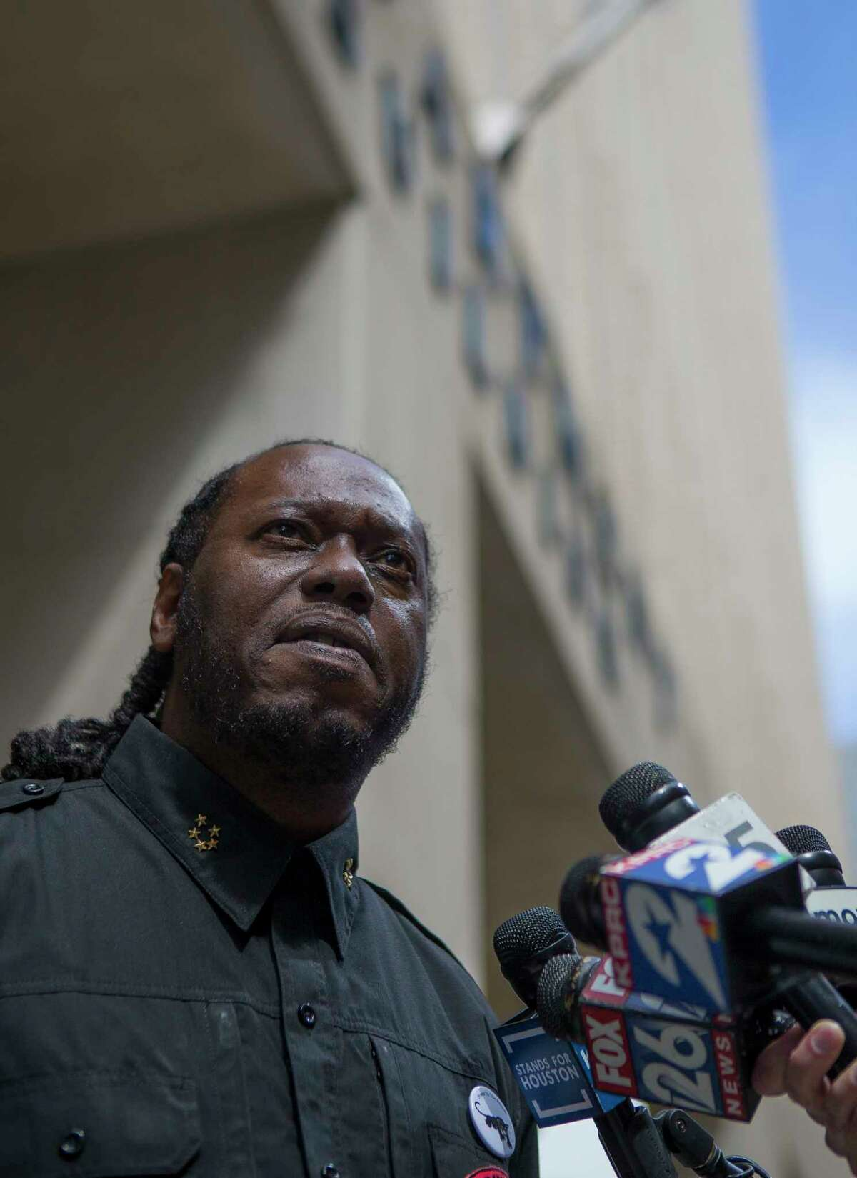 Yahcanon Ben Yah, with The People's New Black Panther Party, addresses the media in front of the Houston Police Department headquarters building in downtown Houston, Monday, Feb. 18, 2019. Activists said they were calling for police accountability and a murder charge the narcotics agent accused of fabricating evidence used to justify a no-knock raid that left two civilians dead.