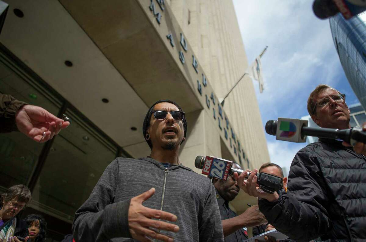 Richard Molina, whose uncle, Joe Canpis Torres, was 23 when he was beaten to death by HPD officers in 1977, addresses the media in front of the Houston Police Department headquarters building in downtown Houston, Monday, Feb. 18, 2019. Activists said they were calling for police accountability and a murder charge the narcotics agent accused of fabricating evidence used to justify a no-knock raid that left two civilians dead.