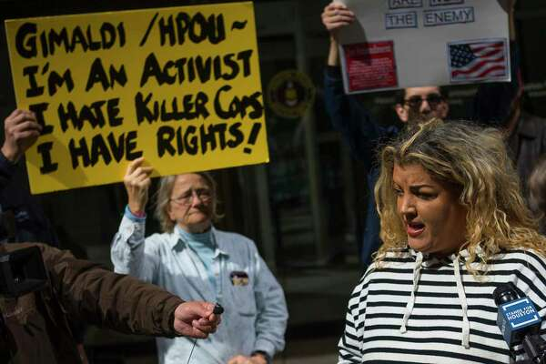 Protesters demand murder charge against cop involved in
