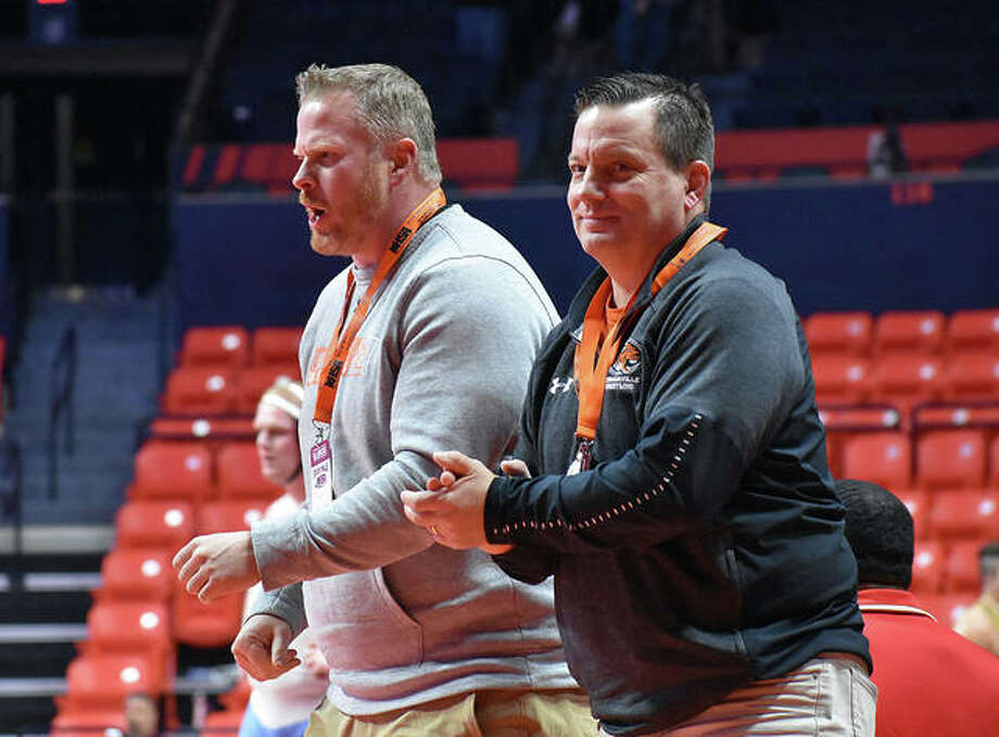 Edwardsville head coach Jon Wagner, right, and assistant coach Doug Heinz celebrate after Lloyd Reynolds picks up a victory in a consolation match Friday. Photo: Matt Kamp/Intelligencer