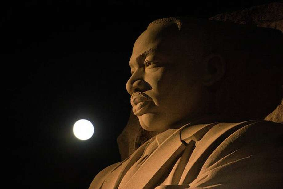 The moon, or supermoon, as it sets over the Martin Luther King Jr. Memorial on Monday, Nov. 14, 2016. Photo: NASA/Aubrey Gemignani