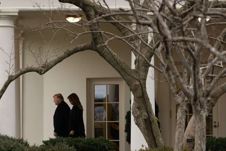WASHINGTON, DC - FEBRUARY 15: U.S. President Donald Trump and first lady Melania Trump leave the Oval Office of the White House prior to their departure on February 15, 2019 in Washington, DC. Earlier, President Trump declared a national emergency to build a wall on the border. He and the first lady are traveling to his Mar-a-Lago resort in Palm Beach, Florida for the weekend. (Photo by Alex Wong/Getty Images)