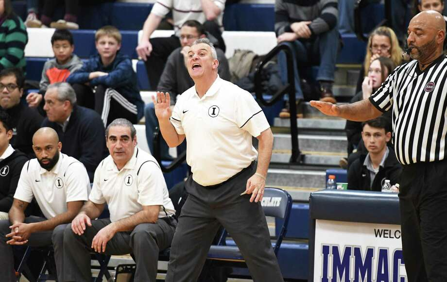 Immaculate boys basketball coach Nelson Mingachos recently won his 200th game. Photo: Krista Benson / Hearst Connecticut Media / The News-Times Freelance