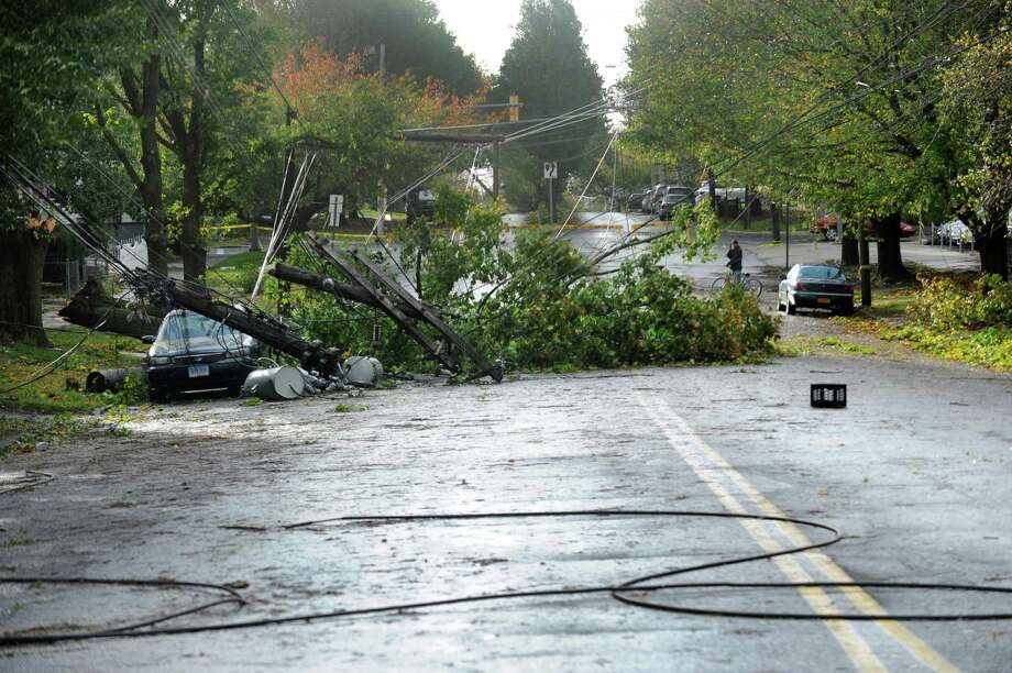 A tree knocked down a telephone pole on Park Avenue in Bridgeport during the height of the wicked weather caused by Superstorm Sandy. Photo: Cathy Zuraw / Cathy Zuraw / Connecticut Post