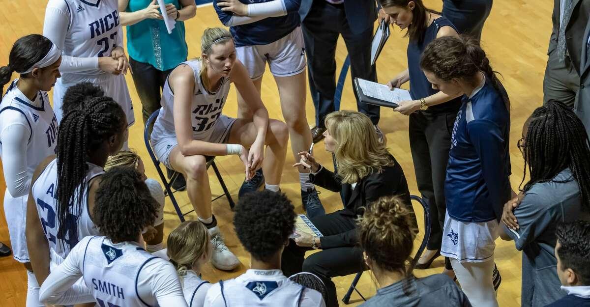 Rice coach Tina Langley talks with team.