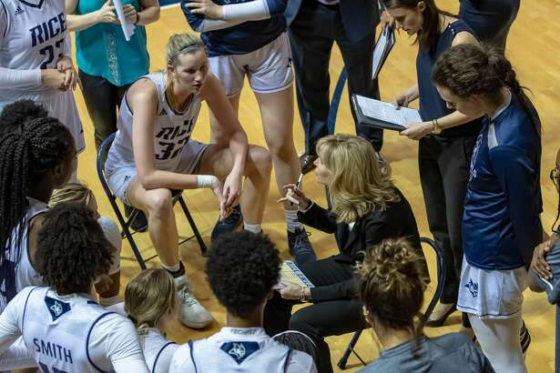 Rice coach Tina Langley talks with team.