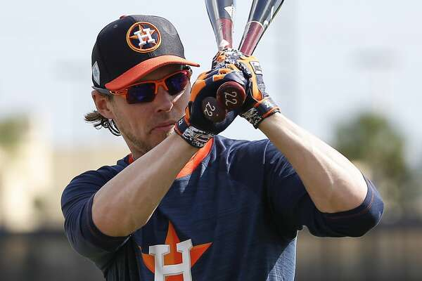 Houston Astros right fielder Josh Reddick (22) swings his bats to get ready for batting practice at Fitteam Ballpark of The Palm Beaches on Day 5 of spring training on Monday, Feb. 18, 2019, in West Palm Beach.