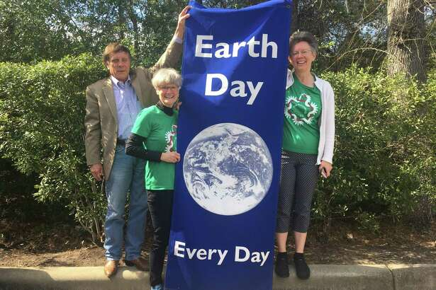 The Woodlands GREEN organization is celebrating three decades of evolving environmental work in the community. Here, president Paul Nelson, secretary Kathie Herrick and board member Carolyn Newman hold an organization banner.