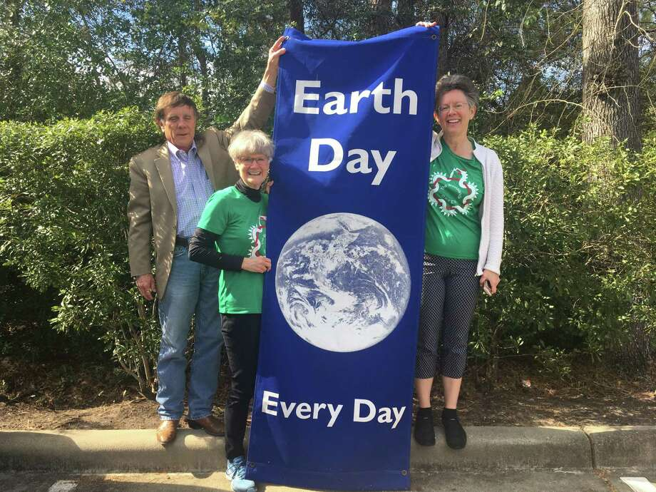 The Woodlands GREEN organization is celebrating three decades of evolving environmental work in the community. Here, president Paul Nelson, secretary Kathie Herrick and board member Carolyn Newman hold an organization banner. Photo: Courtesy Photos / Courtesy Photos