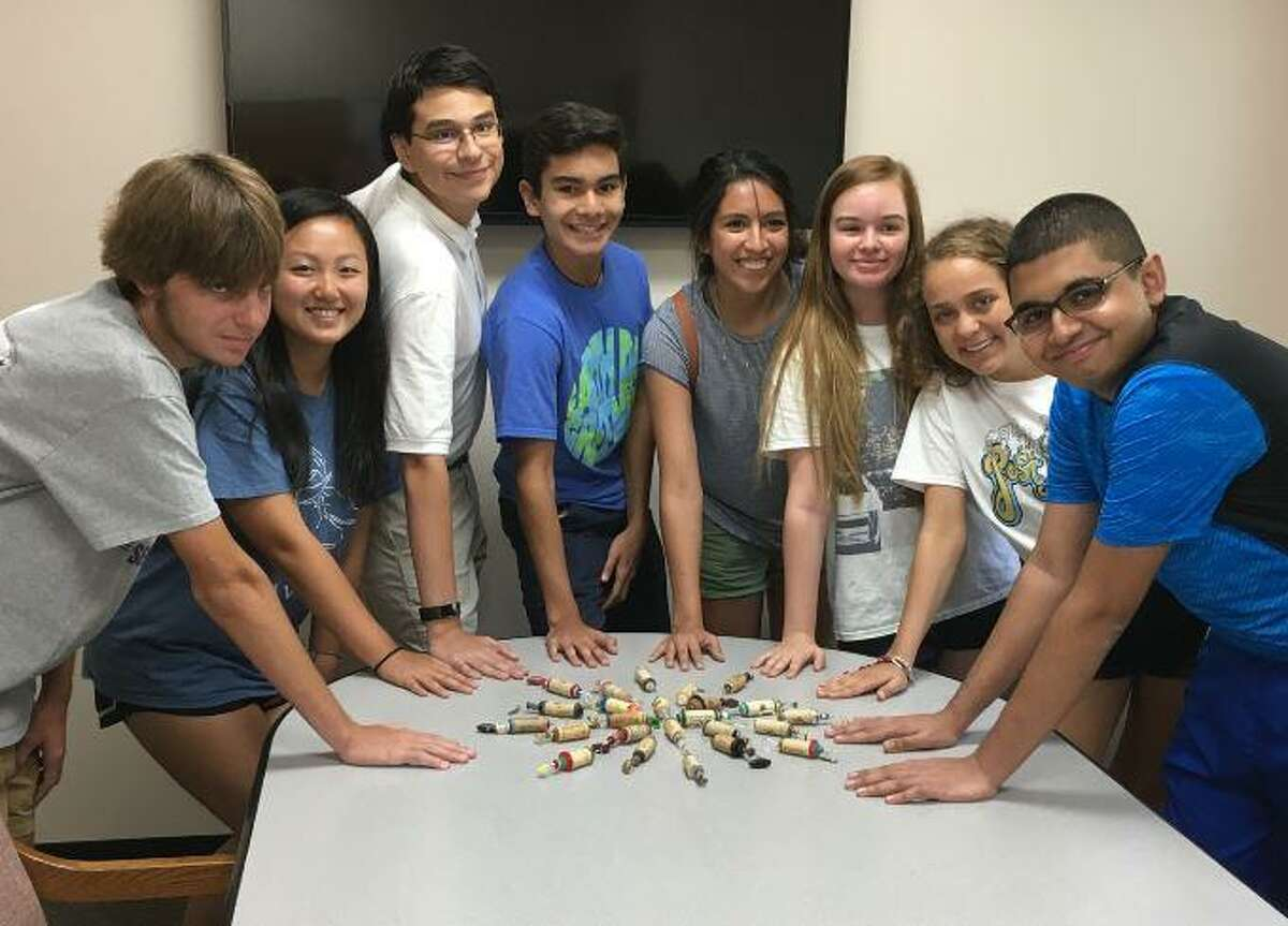 The Woodlands GREEN organization is celebrating three decades of evolving environmental work in the community. Here, a group of student ambassadors show off a recycled craft project.