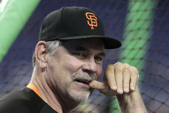 FILE - In this June 12, 2018, file photo, San Francisco Giants manager Bruce Bochy watches batting practice before a baseball game against the Miami Marlins, in Miami. Bochy says he will retire after this season, his 25th as a big league manager. Bochy says he told the team of his decision on Monday, Feb. 18, 2019. (AP Photo/Lynne Sladky, File)