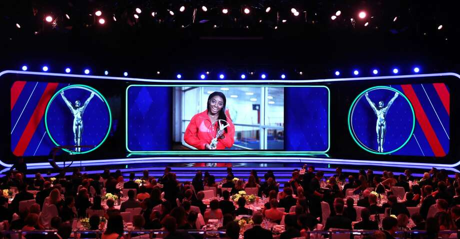 PHOTOS: Facts about Simone Biles Laureus World Sportswoman of The Year 2019 Simone Biles accepts her award via video screen during the 2019 Laureus World Sports Awards on February 18, 2019 in Monaco, Monaco. (Photo by Matthew Lewis/Getty Images for Laureus) Browse through the photos to learn about Spring's Simone Biles.  Photo: Matthew Lewis/Getty Images For Laureus