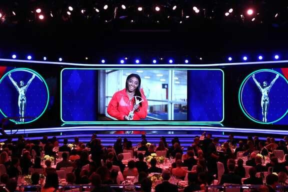 MONACO, MONACO - FEBRUARY 18:  Laureus World Sportswoman of The Year 2019 Simone Biles accepts her award via video screen during the 2019 Laureus World Sports Awards on February 18, 2019 in Monaco, Monaco. (Photo by Matthew Lewis/Getty Images for Laureus)