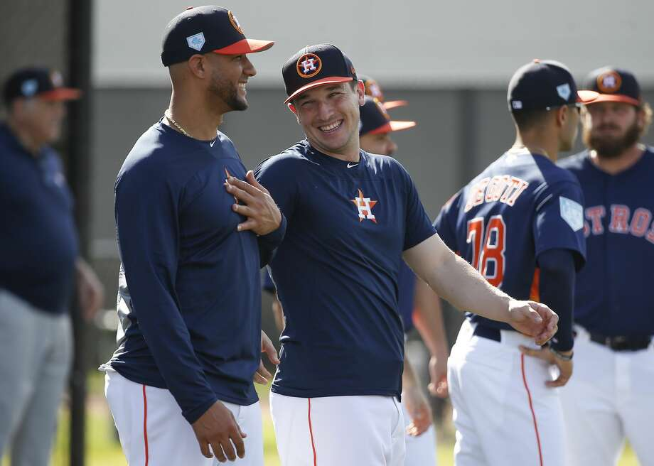 """PHOTOS: Alex Bregman's greatest on- and off-the field moments Houston Astros infielders Yuli Gurriel (10) and Alex Bregman (2) share a laught while warming up for the first full-squad practice at Fitteam Ballpark of The Palm Beaches on Monday, Feb. 18, 2019, in West Palm Beach. The boys play on """"The Future"""" baseball team. >>>A look at the greatest moments - on the field and off the field - for the Astros' Alex Bregman ... Photo: Yi-Chin Lee/Staff Photographer"""