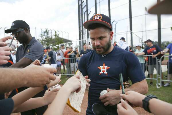 Many fans try to get autographs from Houston Astros second baseman Jose Altuve (27) after the first full-squad practice at Fitteam Ballpark of The Palm Beaches on Monday, Feb. 18, 2019, in West Palm Beach.