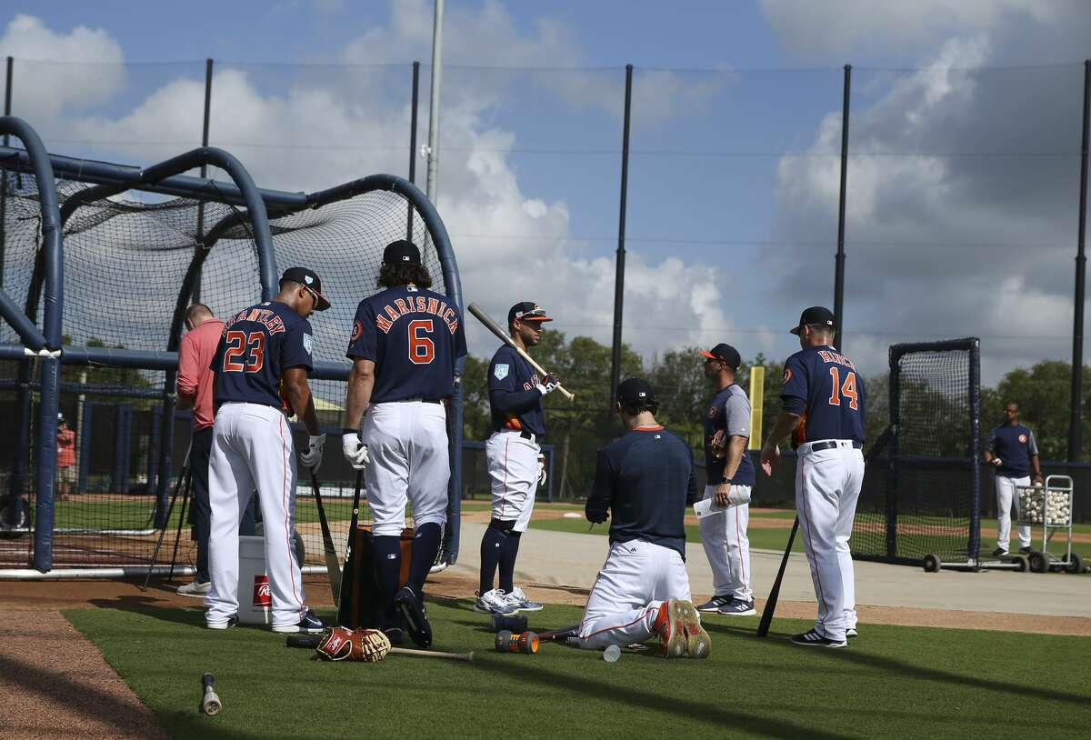 Houston Astros possible starting outfielders Michael Brantley (23), Jake Marisnick (6), George Springer (4) and Josh Reddick (22) are ready to start batting practice while manager AJ Hinch (14) is watching during the first full-squad practice at Fitteam Ballpark of The Palm Beaches on Monday, Feb. 18, 2019, in West Palm Beach.