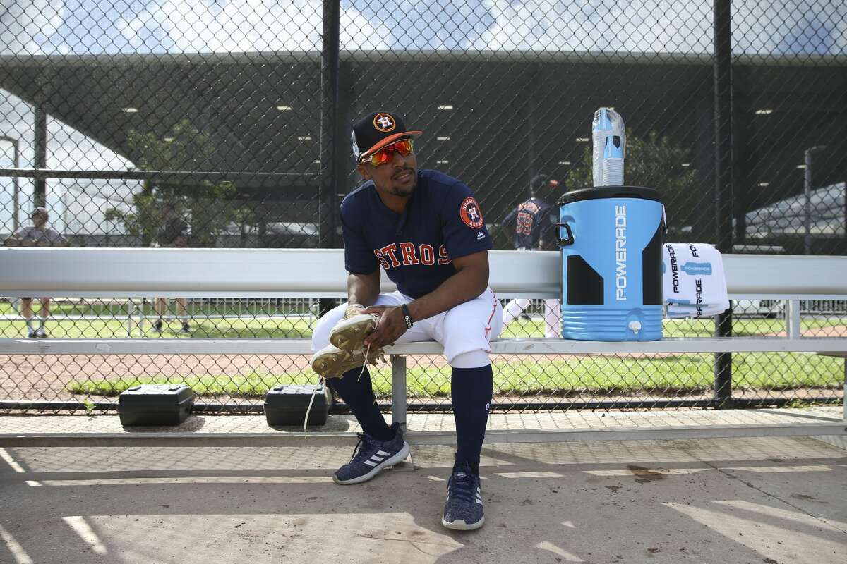 Houston Astros outfielder Tony Kemp (18) is ready for the next practice after changing shoes during the first full-squad practice at Fitteam Ballpark of The Palm Beaches on Monday, Feb. 18, 2019, in West Palm Beach.