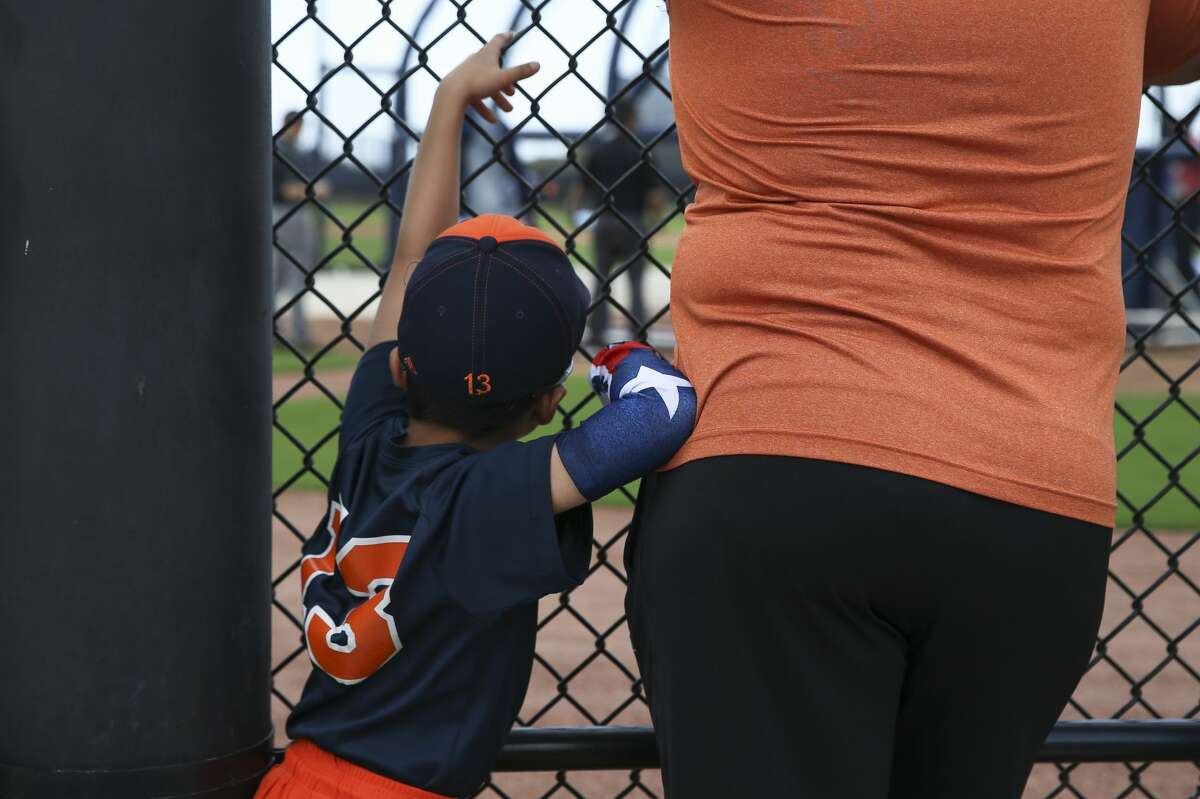 Enzo Hernandez, 6, of Miami, watches Houston Astros playrs during batting practice on the first full-squad practice at Fitteam Ballpark of The Palm Beaches on Monday, Feb. 18, 2019, in West Palm Beach. Enzo plays on