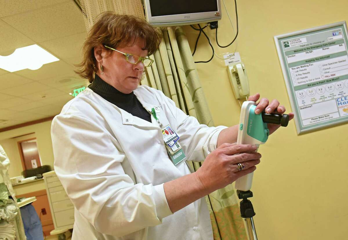 Registered nurse Tina Bagley holds a colposcope used to examine sexual assault victims in an exam room at Nathan Littauer Hospital on Monday, Feb. 18, 2019 in Gloversville, N.Y. She is able to communicate with a nurse practitioner like Nancy Harris, program director for United Concierge Medicine TeleSAFE promgram. The SAFE providers help walk any medical provider or RN through this important forensic exam using telemedicine. (Lori Van Buren/Times Union)