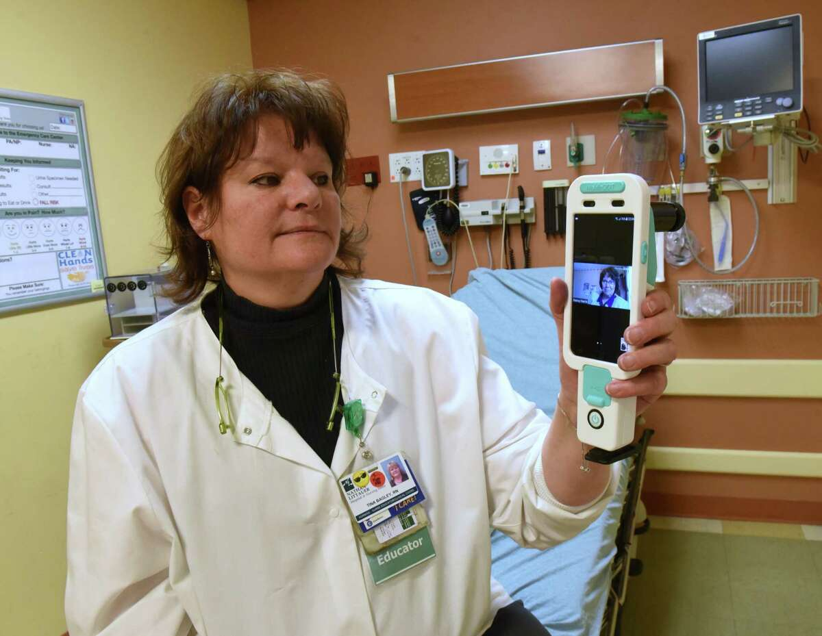 Registered nurse Tina Bagley holds a colposcope used to examine sexual assault victims in an exam room at Nathan Littauer Hospital on Monday, Feb. 18, 2019 in Gloversville, N.Y. She is able to communicate with a nurse practitioner like Nancy Harris, program director for United Concierge Medicine TeleSAFE promgram, on screen. The SAFE providers help walk any medical provider or RN through this important forensic exam using telemedicine. (Lori Van Buren/Times Union)