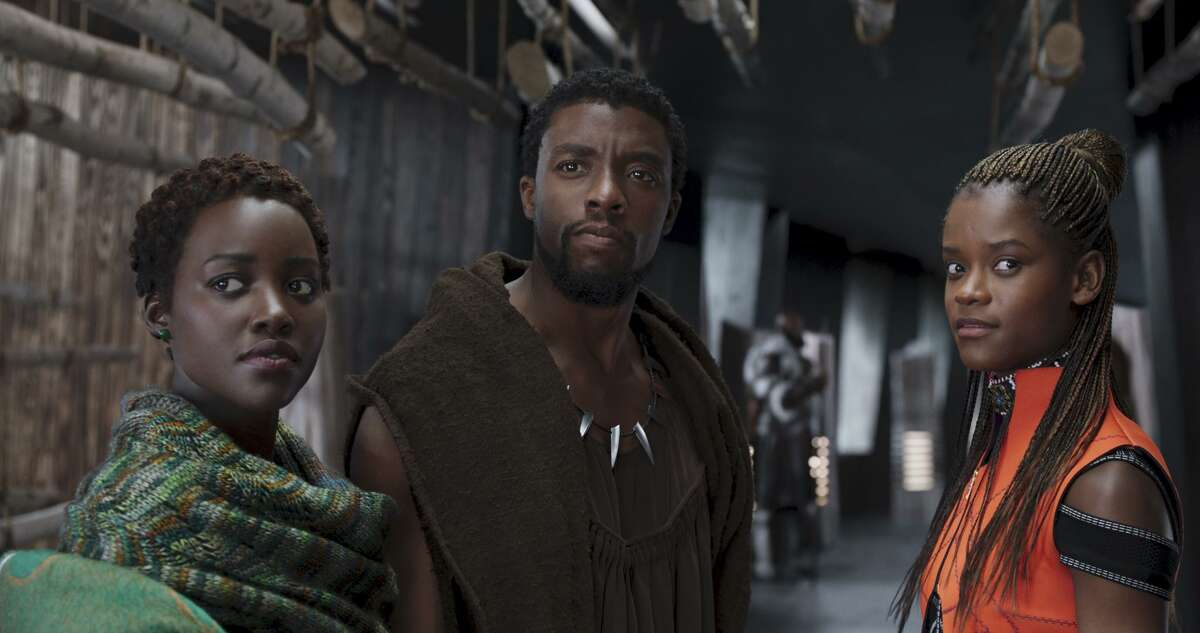 """Lupita Nyong'o, from left, Chadwick Boseman and Letitia Wright in a scene from """"Black Panther."""""""