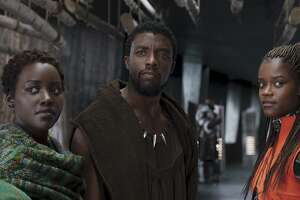 "Lupita Nyong'o, from left, Chadwick Boseman and Letitia Wright in a scene from ""Black Panther."""