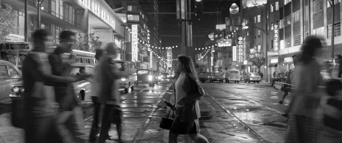 "Yalitza Aparicio crosses the intersection of Baja California and Insurgentes avenues in Alfonso Cuarón's ""Roma."""