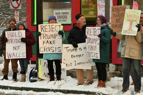 Bethlehem Neighbors for Peace gather to join a national action on President's Day to protest President Trump's declaration of a national emergency for border wall funding at the Four Corners on Monday, Feb. 18, 2019 in Delmar, N.Y. (Lori Van Buren/Times Union)