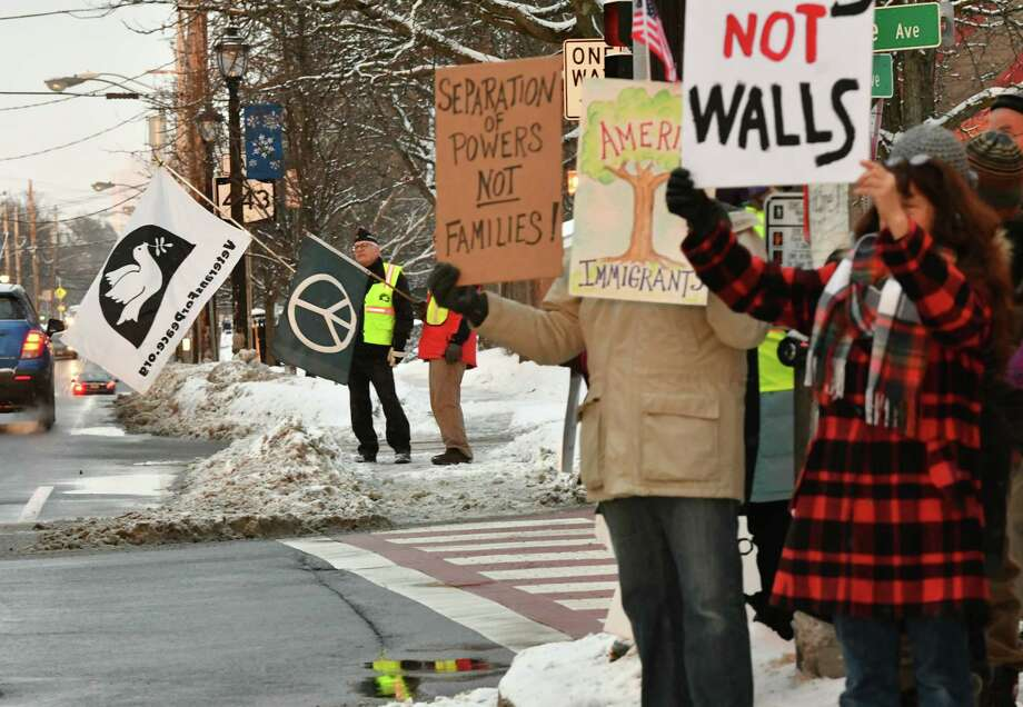 Bethlehem Neighbors for Peace gather to join a national action on President's Day to protest Trump's declaration of a national emergency for border wall funding at the four corners on Monday, Feb. 18, 2019 in Delmar, N.Y. (Lori Van Buren/Times Union) Photo: Lori Van Buren, Albany Times Union / 40046227A