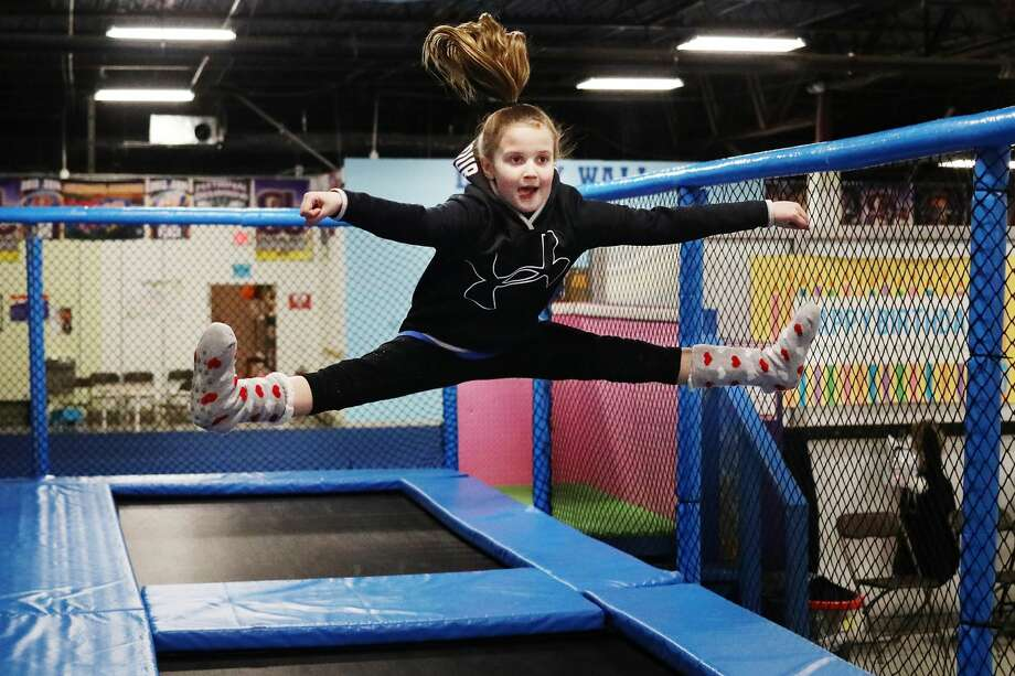 Midland resident Jordis Havens, 9, practices a toe touch at Aftershock Indoor Trampoline Park on Monday, Feb. 18, 2019. (Katy Kildee/kkildee@mdn.net) Photo: (Katy Kildee/kkildee@mdn.net)