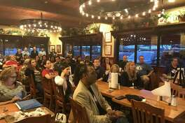 Parents and community members attend Pearland ISD trustee Mike Floyd's town hall meeting in March at Spring Creek Barbeque. The district's board agreed in October to stage forums for the community twice a year at district facilities.