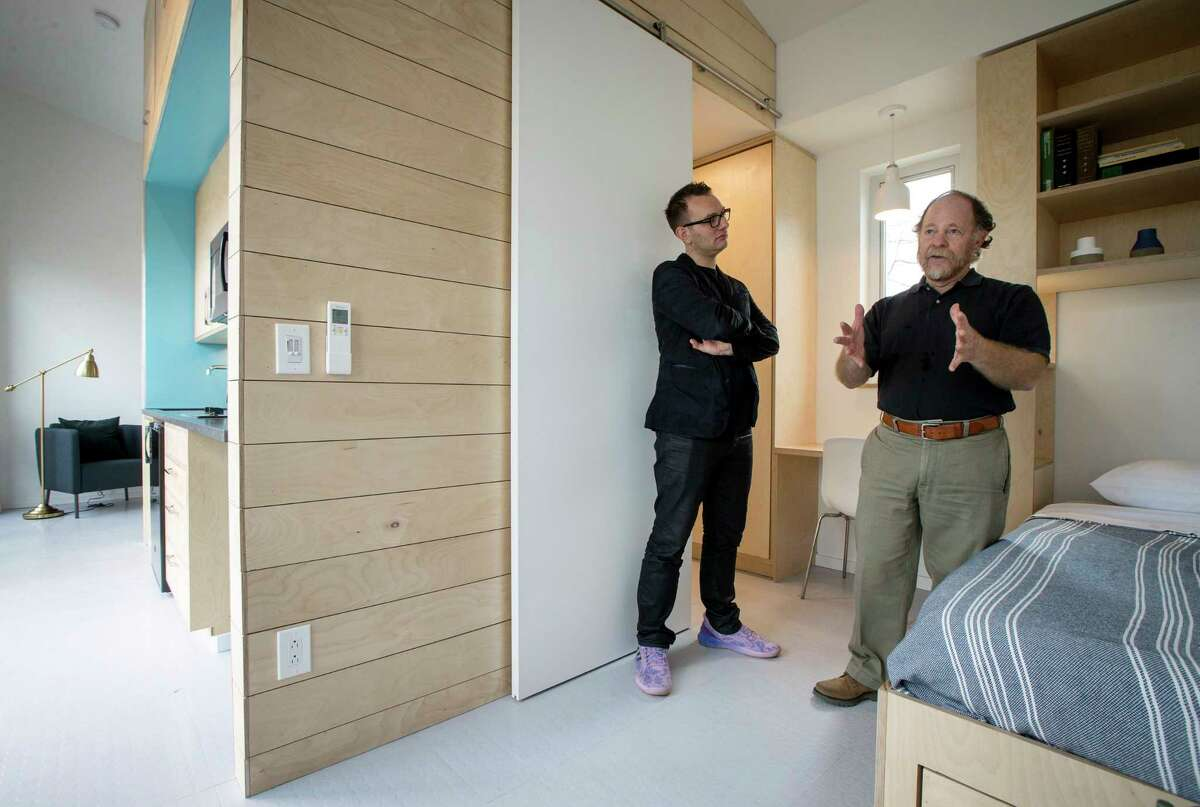 Andrew Colopy, left, an assistant professor at Rice University, and Danny Samuels, a professor in practice at Rice, give a tour of an accessory dwelling unit built by their architecture students for Agape Development, which works in a small neighborhood to improve housing.